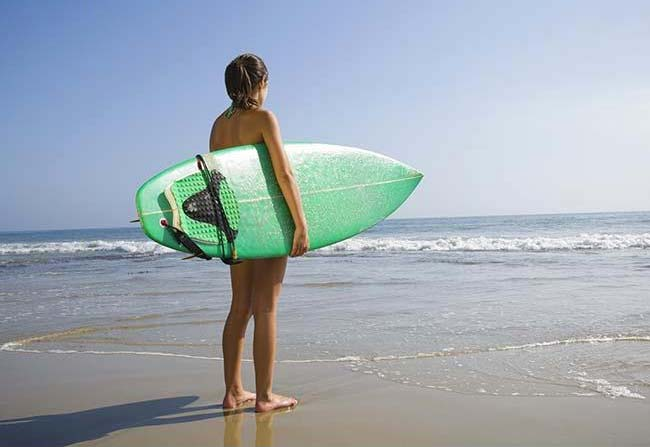 girl holding surfboard