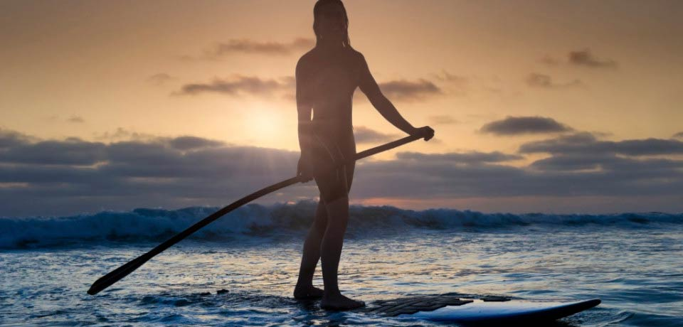 silhouette of girl on paddleboard